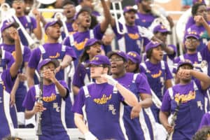 Benedict College band members cheer for the football team.